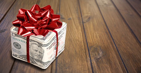 Money wrapped as a gift with a large bow