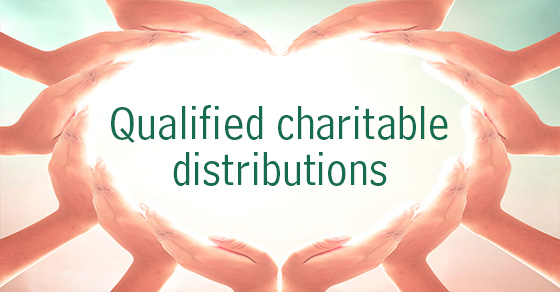 Hands in the shape of a heart around the words qualified charitable distributions
