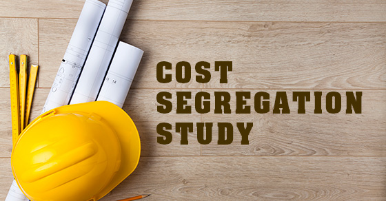 Blueprints and a hard hat with the words Cost Segregation Study