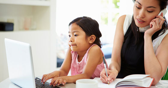 A women working at home with her child.
