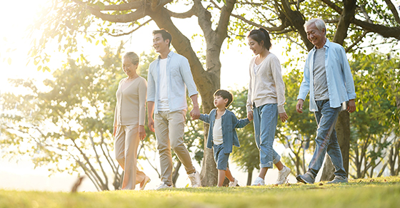 Multi-generational family take a walk in the park