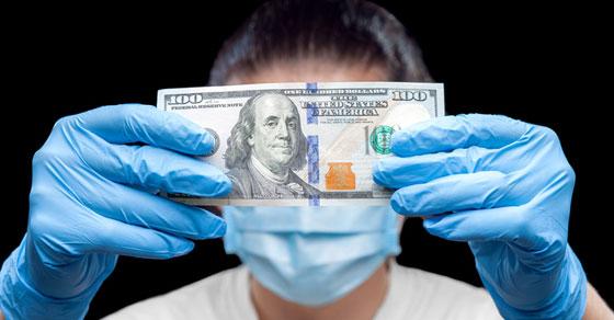 Hundred dollar bill being inspected