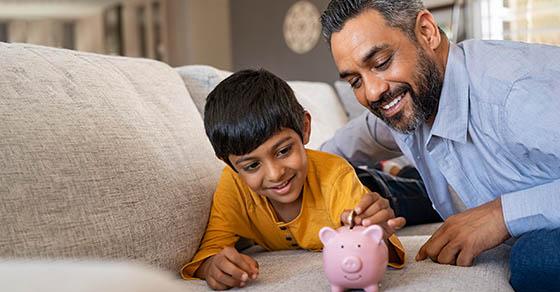 Boy saving money in piggybank