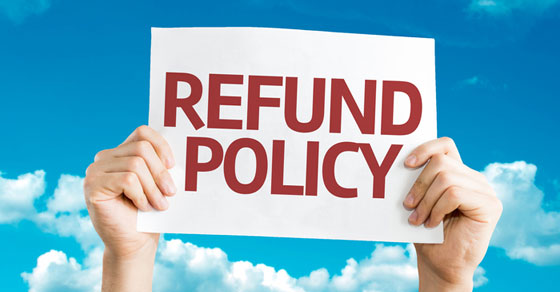 """Hands holding a """"refund policy"""" sign"""