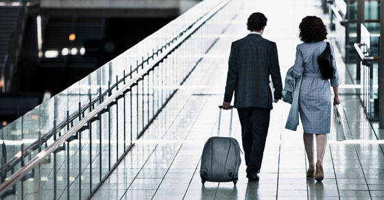 Two people walking through an airport