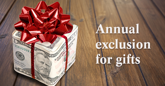 gift wrapped in $50 & $100 bills with a red ribbon on top